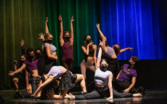 Dancing to Lady Gaga's 'Born This Way,' members of the cast strike their final poses with a rainbow background behind them.